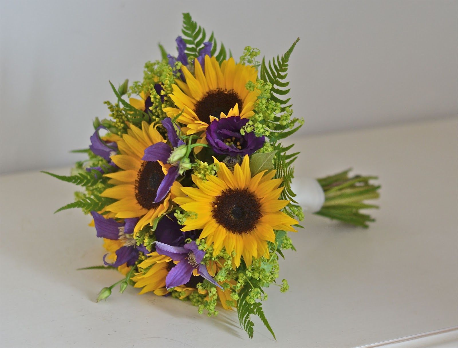 Sunflower Corsages Mini Sunflower Bouquet Using Purple Clematis