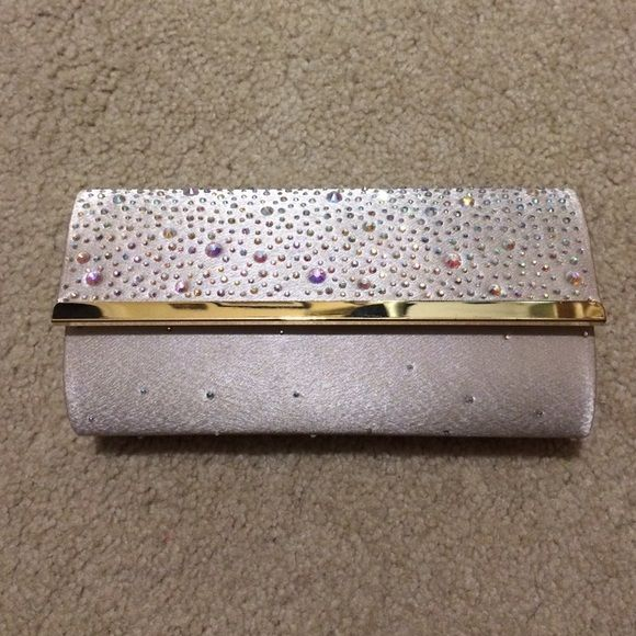 Charming Charlie's Aurora Borealis Clutch Like new condition. No missing rhinestones, and the clasp works perfectly. The removable strap is included in the clutch. Used at prom once, and it's the perfect accessory! Comment with questions or offers, trying to get rid of this! Charming Charlie Bags Clutches & Wristlets