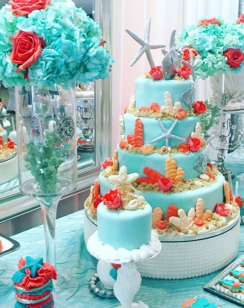 52a3f48edb8 Amazing seashell and coral cake at an under the sea Quinceañera party! See  more party planning ideas at CatchMyParty.com!