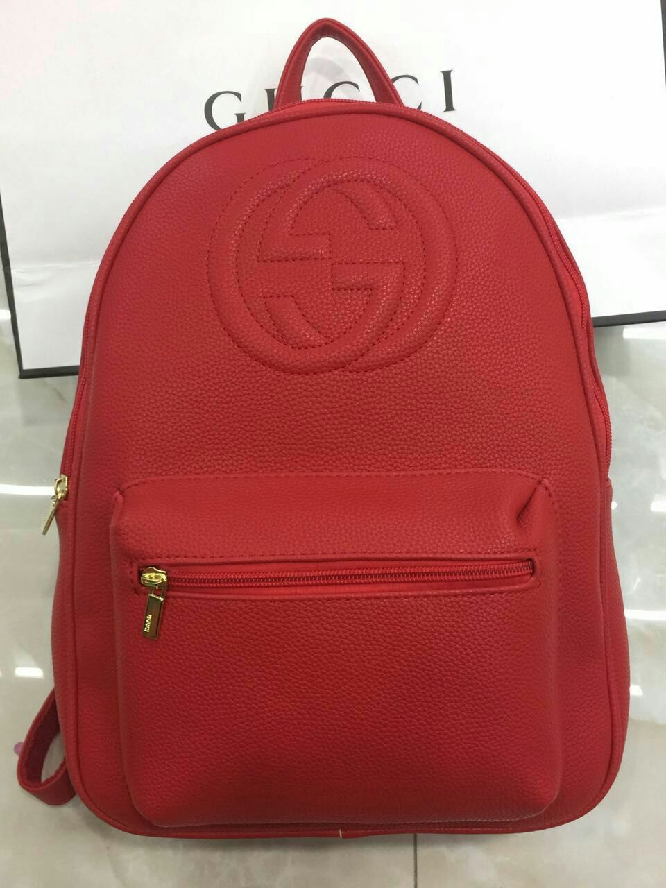 red gucci backpack