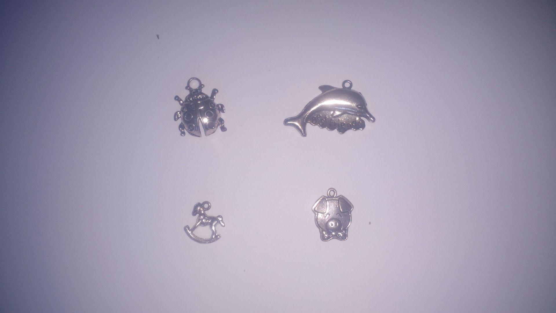 4 breloques coccinelle,dauphin,cheval a bascule,cochon en métal argenté : Animaux par la-mercerie-de-nath