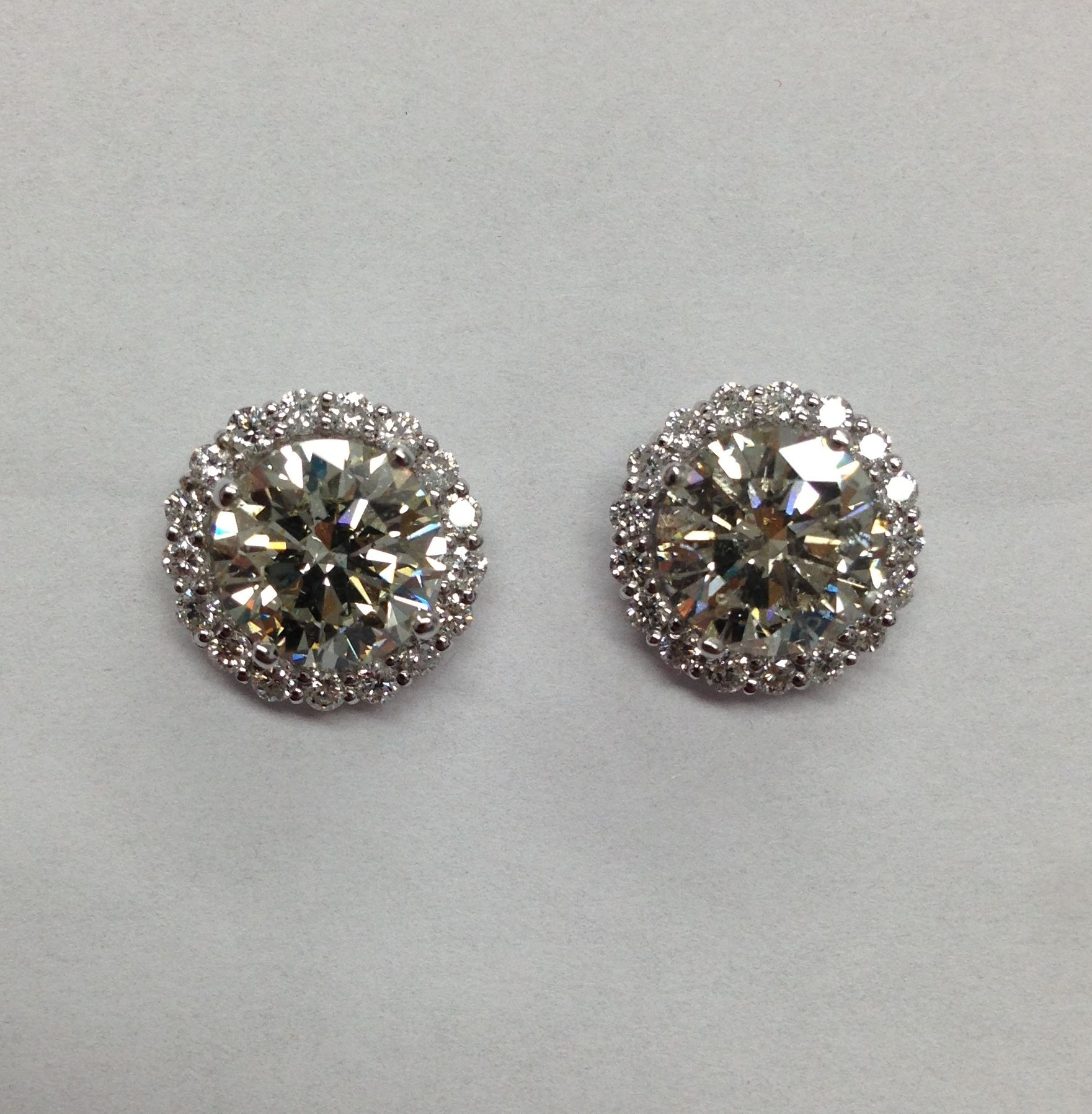 Her 4ct studs with gorgeous Diamond jackets for a WOW look for