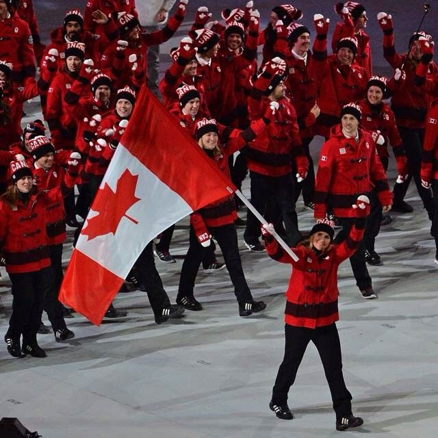 Edmonton Journal S Photo Canada S Flag Bearer Hayley Wickenheiser Waves To The Crowd In Fisht Olympic Stadium In Sochi Russia During The Opening Ceremony Of