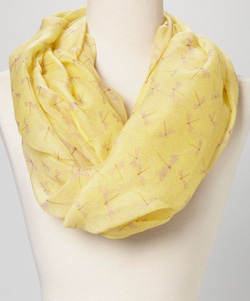 Wrap up in this soft yet sophisticated scarf. The crisp color, gauzy construction and darling dragonfly print combine for a truly pretty piece that's sure to add elegance to any ensemble.