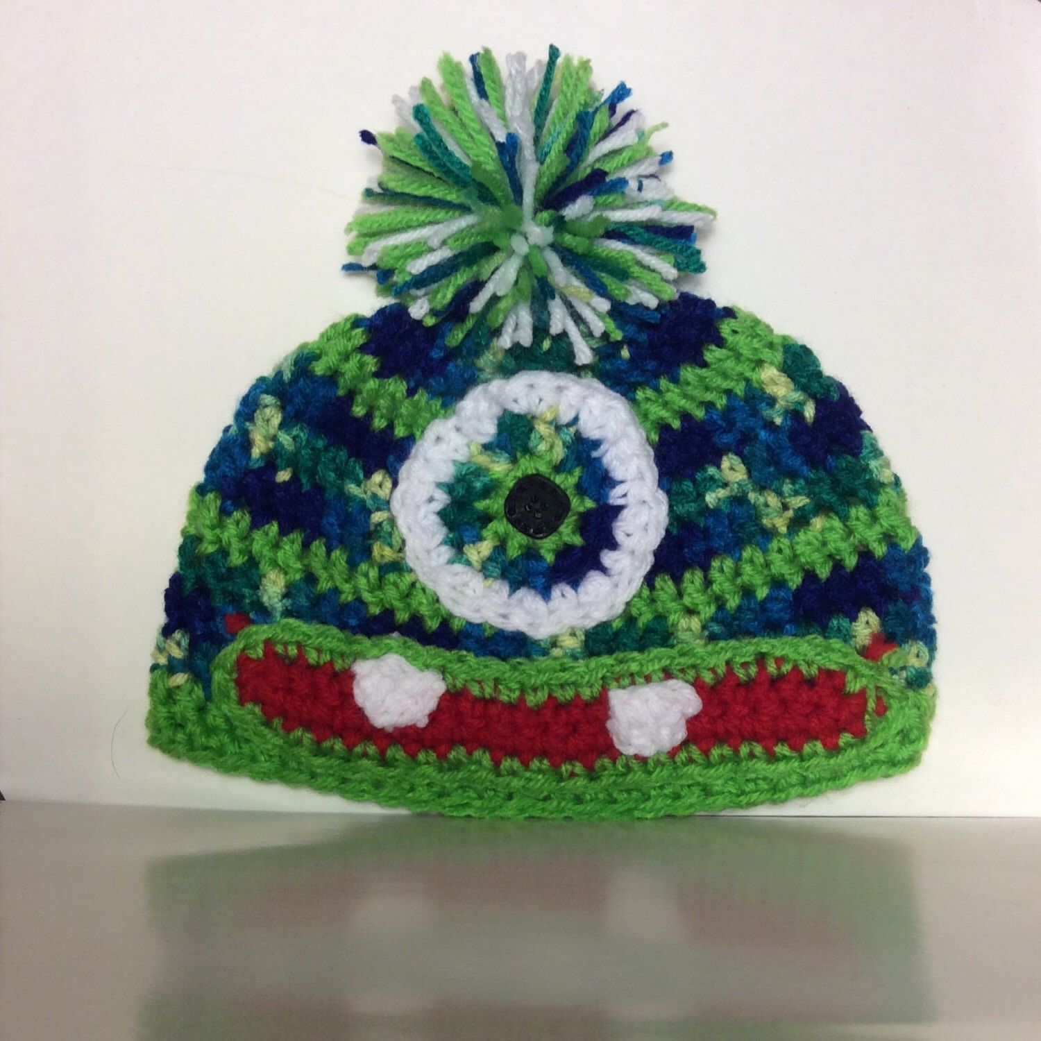 Cute child size one eyed monster hat with Pom Pom 💚💙💚💙💚💚