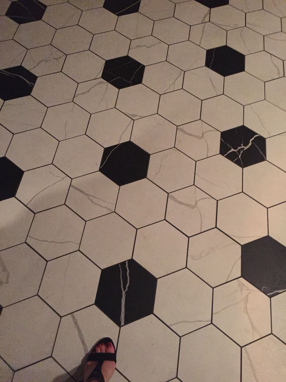 large black and white hex tile floor