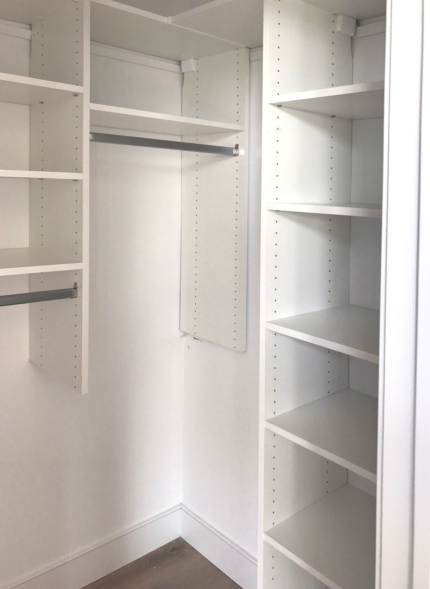 Lots of shelves and hanging in a small corner closet.