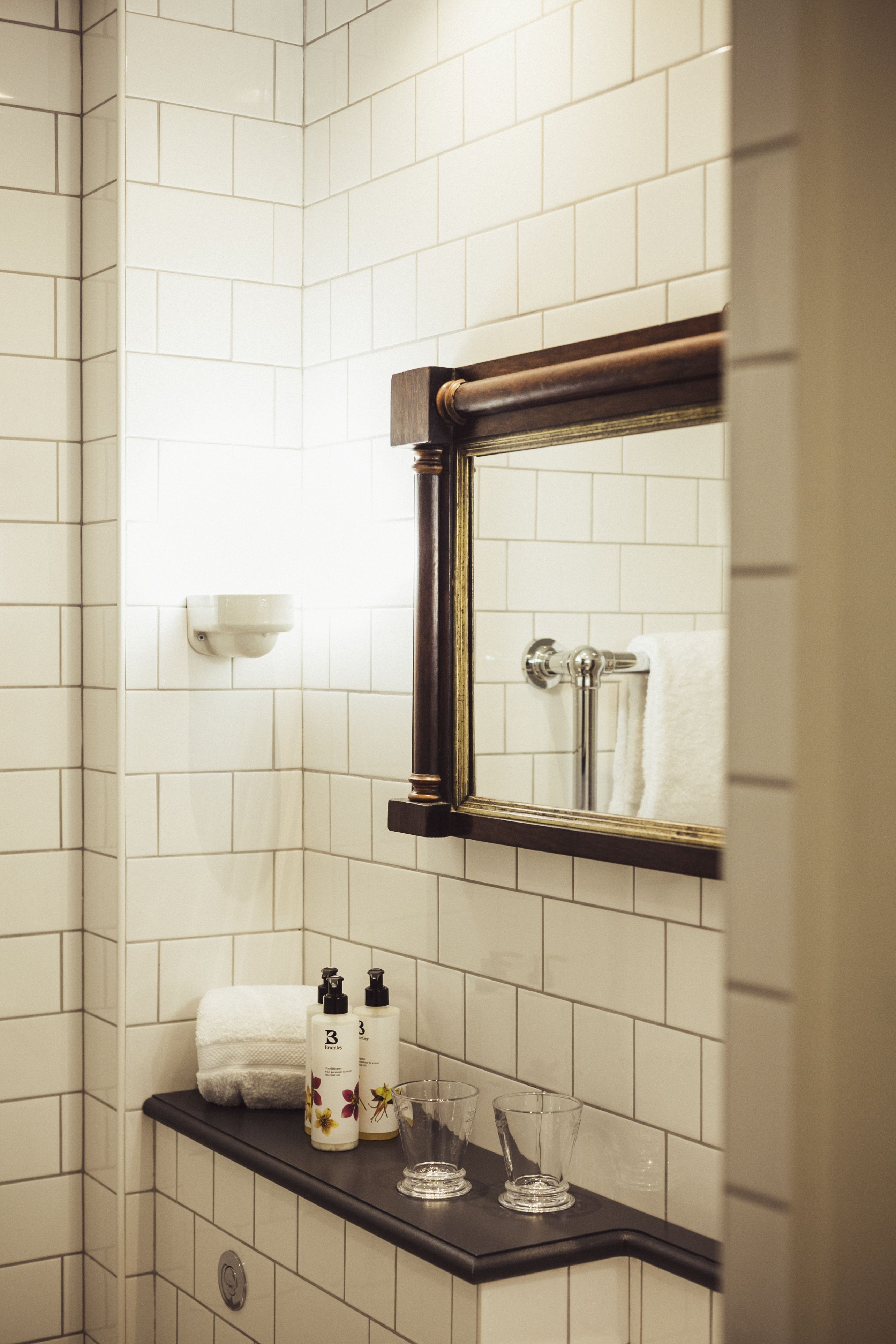 Gorgeous white tiled bathrooms, here at Merchants Manor. For more ...