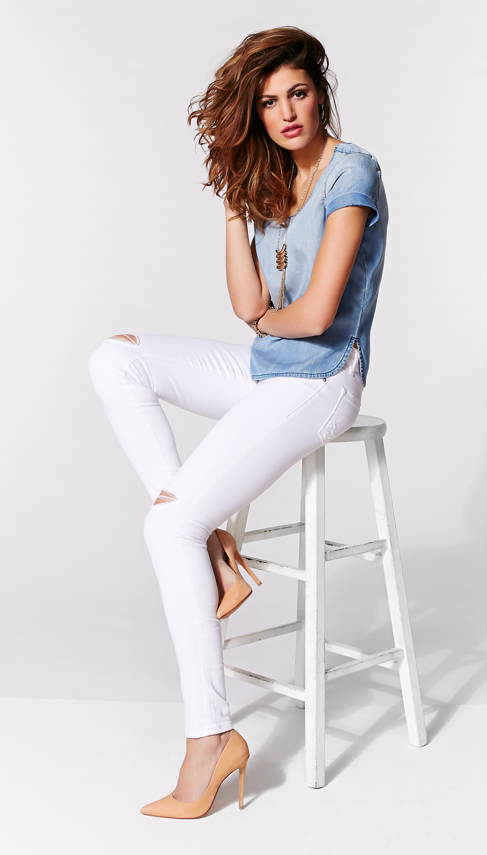 Distressed white jeans are a summer must have.