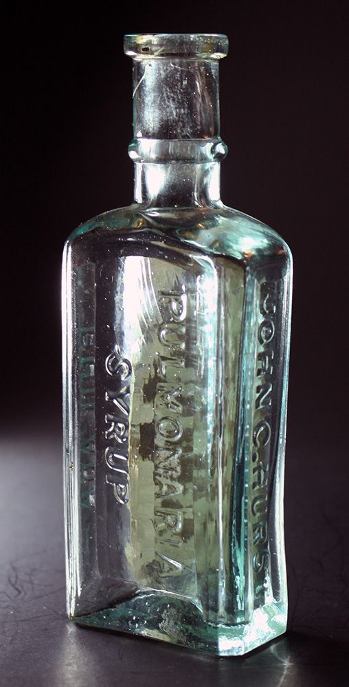 Hurst's Pulmonaria Syrup (back) - aqua, rectangular, molded square ring lip, 5 3/8in (137mm) tall. Embossing: PULMONARIA SYRUP (back panel), JOHN C. HURST (side), PHILADA (other side). Front panel has label. - c1880s maybe a little earlier.