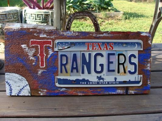Texas Rangers License Plate Sign on vintage cedar barnwood.