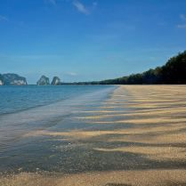The long empty beach in Pak Meng, Thailand, perfect for a peaceful stroll. Trueworldtravels.com