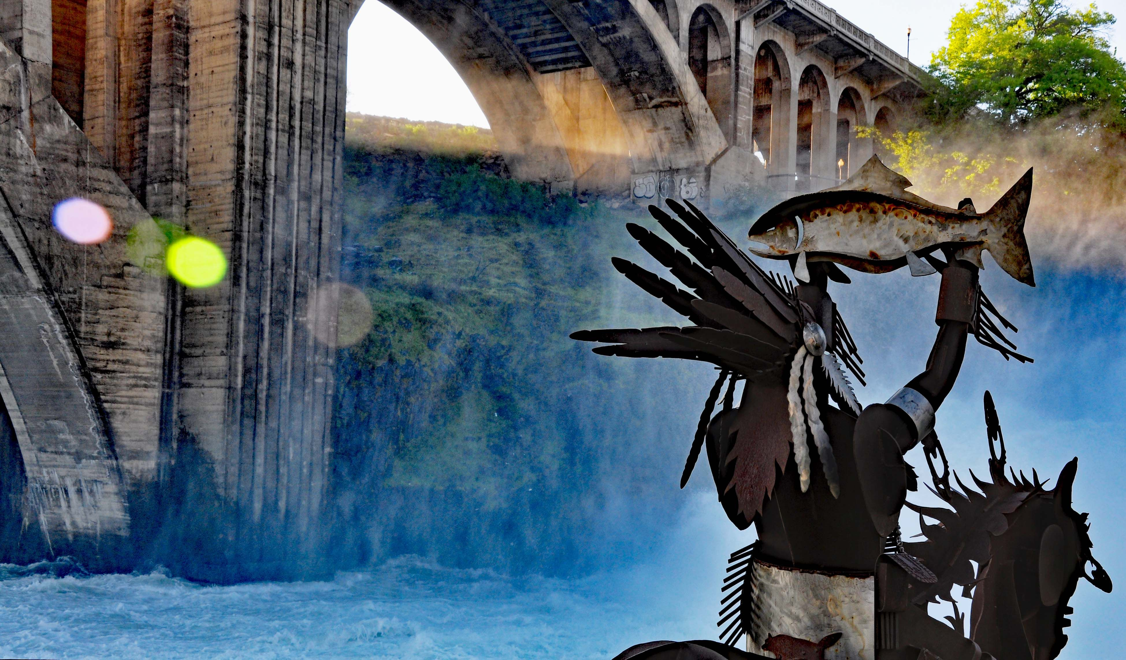 The Salmon Chief Sculpture and Monroe Street Bridge in Spokane, WA ...