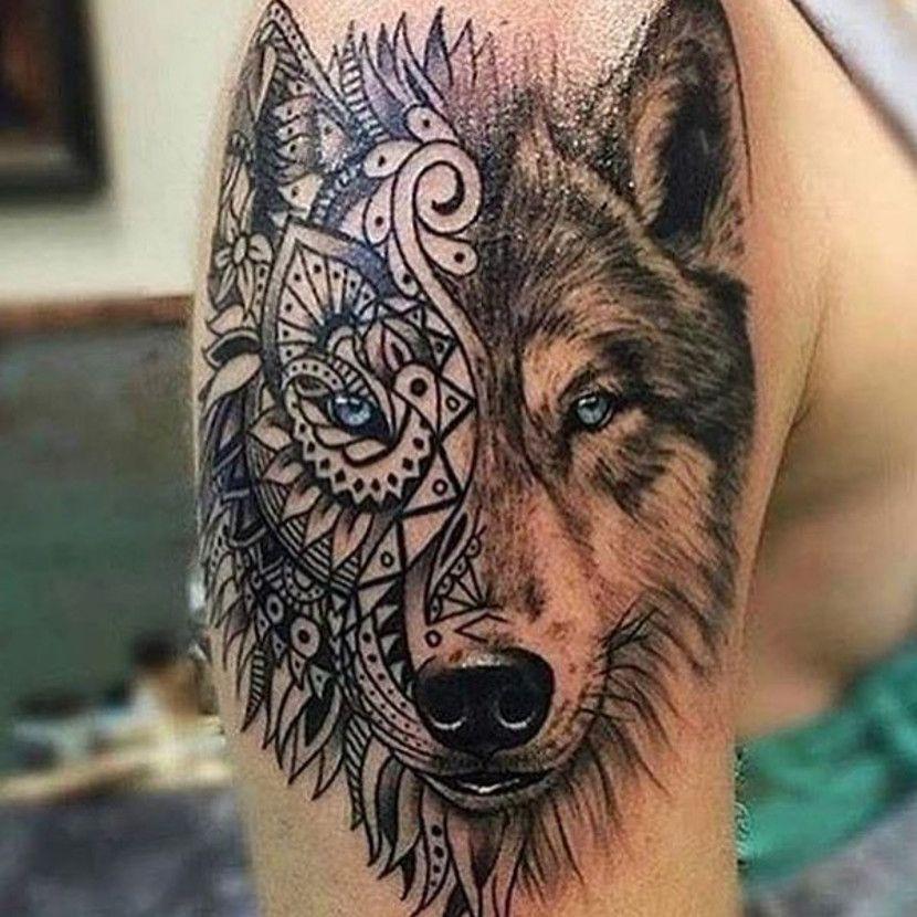 lobo tatuado brazo
