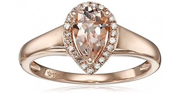 Lovely in its elegance and simplicity! 8X5mm pear-shape Morganite centerpiece framed by 23 diamonds.