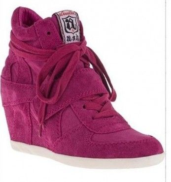 $180.00 These Ash wedge sneakers are the definition of comfort and style, made with soft suede and accented with perforated panels. A Velcro® strap secures the lace-up closure. Hidden wedge heel and rubber sole.