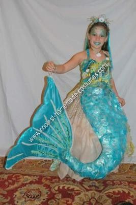 I love this Mermaid costume! Love the iridescent circles attached to the tail to look like scales.  sc 1 st  Pinterest & Coolest Homemade Mermaid on a Rock Unique Halloween Costume Idea ...