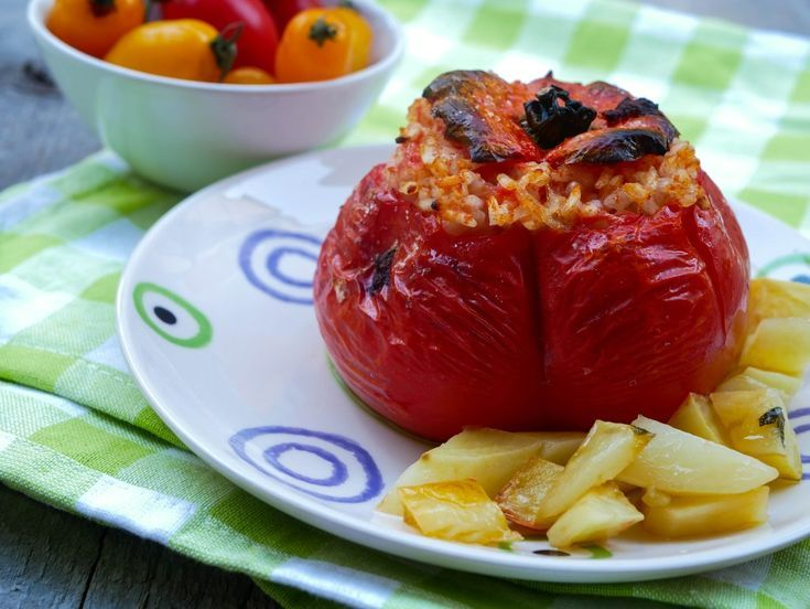 Photo of Red and juicy tomatoes, stuffed with rice, a dish that knows…