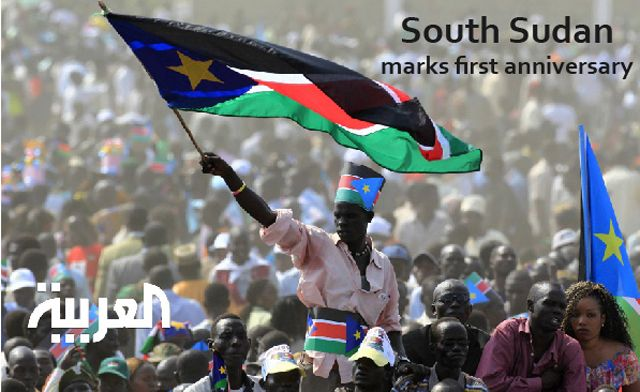 South Sudan marks first anniversary: A man waves South Sudan's national flag as he attends the Independence Day celebrations in the capital Juba on July 9, 2011.