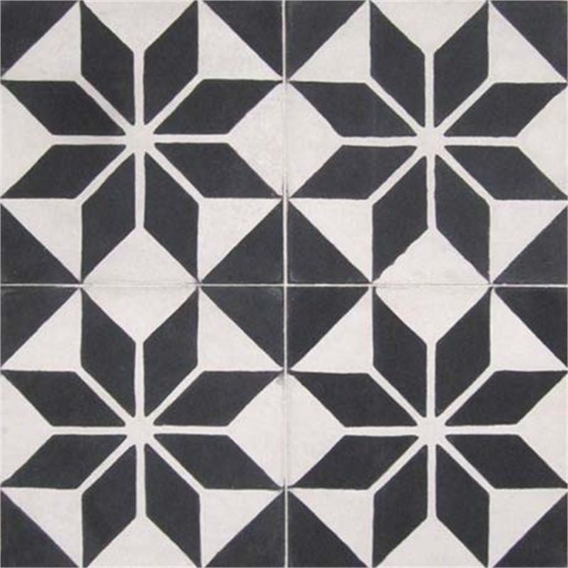 Black and white cement tiles in an art deco quilt like pattern