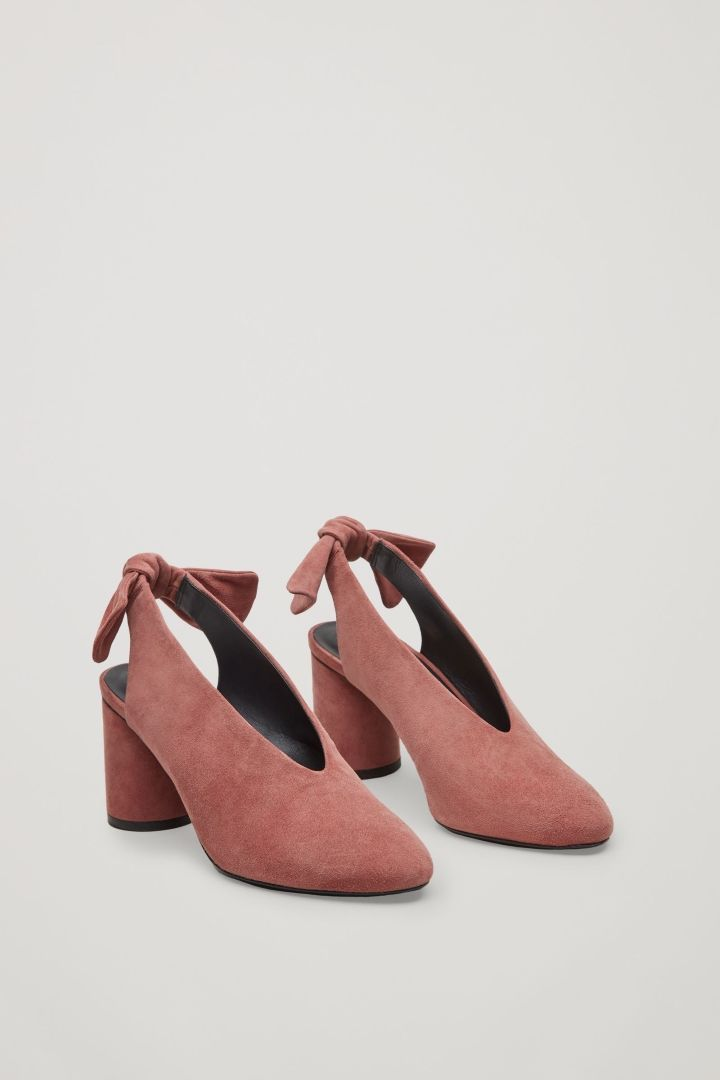 These pump style slingback sandals are made from softly brushed suede with  a tonal       rounded heel A simple       sleek design with a chunky       removable bow  at the