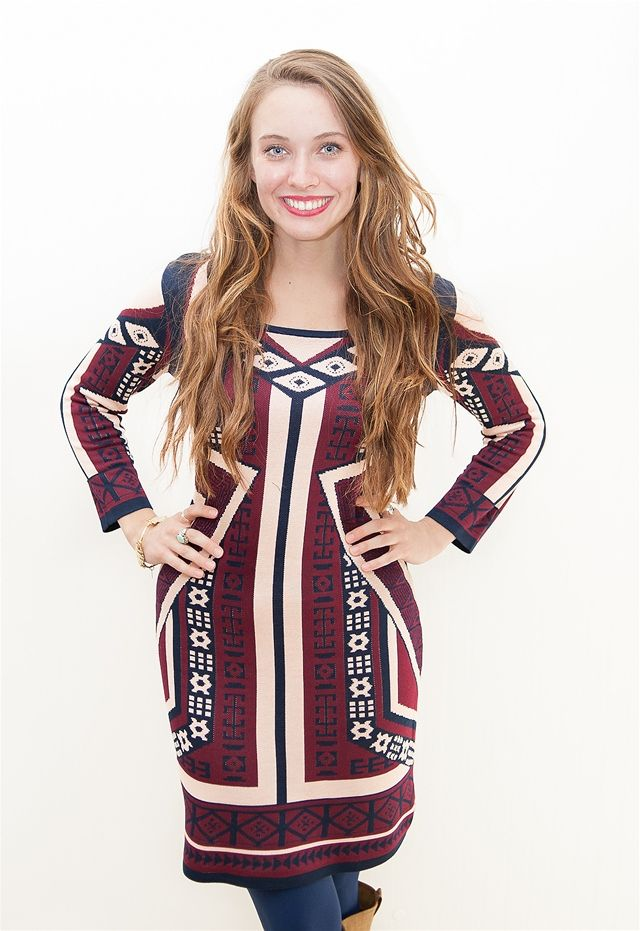 The Wine & Navy Fitted Sweater Dress - This long sleeve sweater dress features a wine and navy multi pattern design and crossed front. Long sleeves. Looks great with boots!  Dress and Dwell - Good things for you and your home
