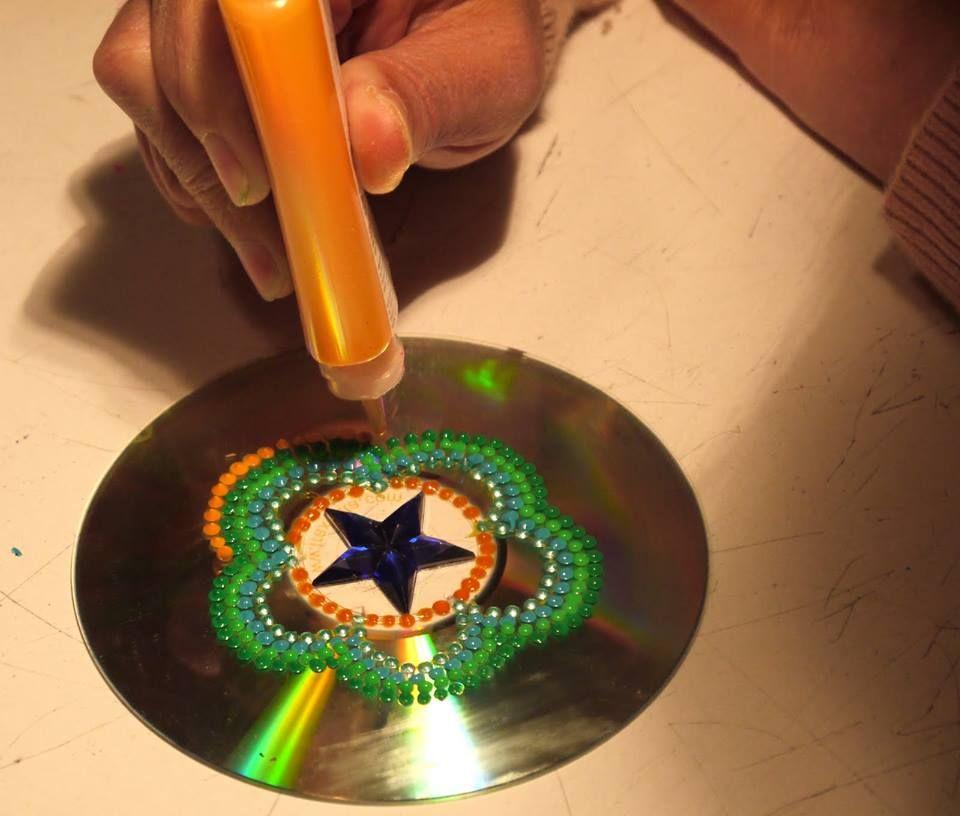 Eco ideas y reciclaje con discos usados bellos mandalas - Manualidades con cd usados ...