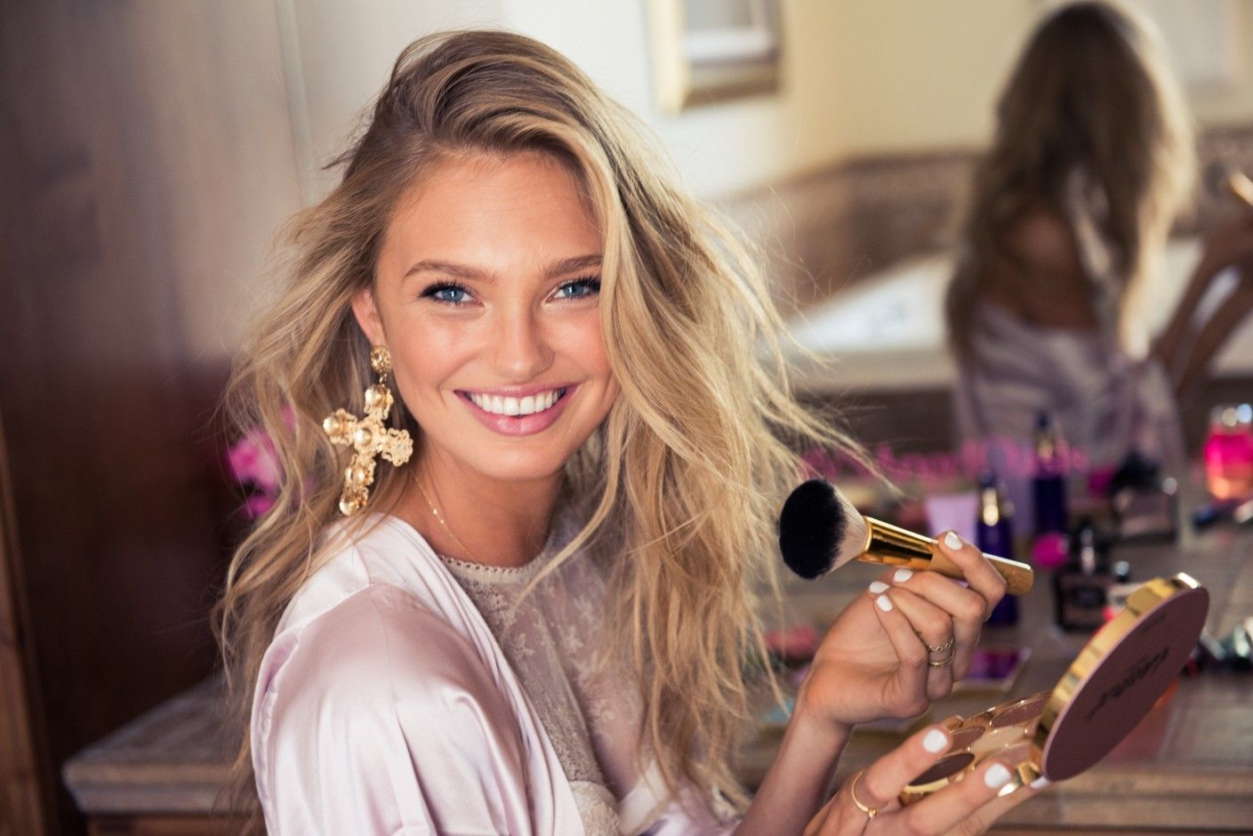 Getting Ready for Coachella with Victoria's Secret Angel Romee Strijd: Their sparkly makeup and ridiculously good hair. How they manage to nail the whole festival look—in 90-degree heat, no less!—while still setting trends that the rest of the world will follow all summer long. -- Lace crop top and denim shorts.   Coveteur.com