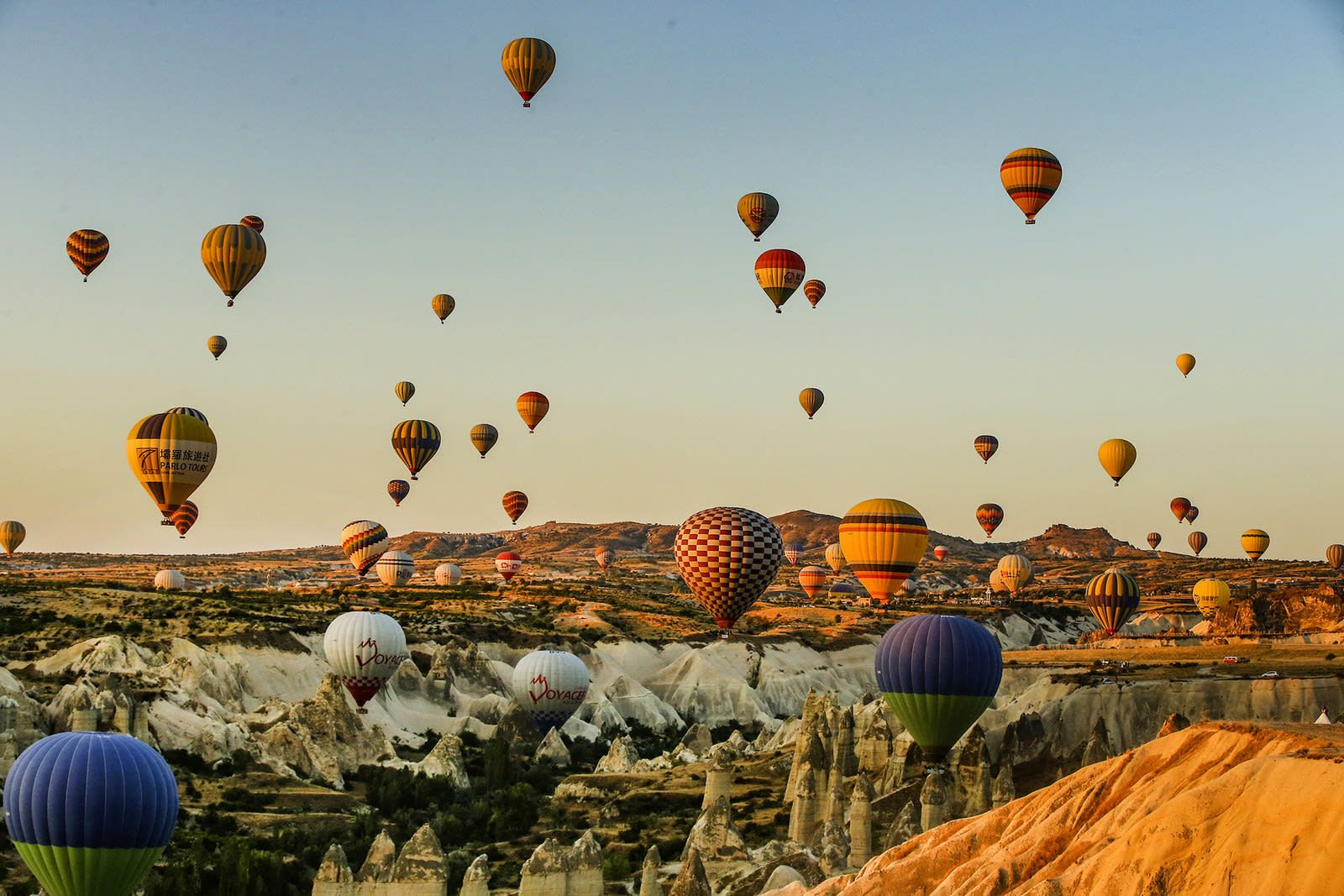Hot air balloons carrying tourists in the sky at sunrise