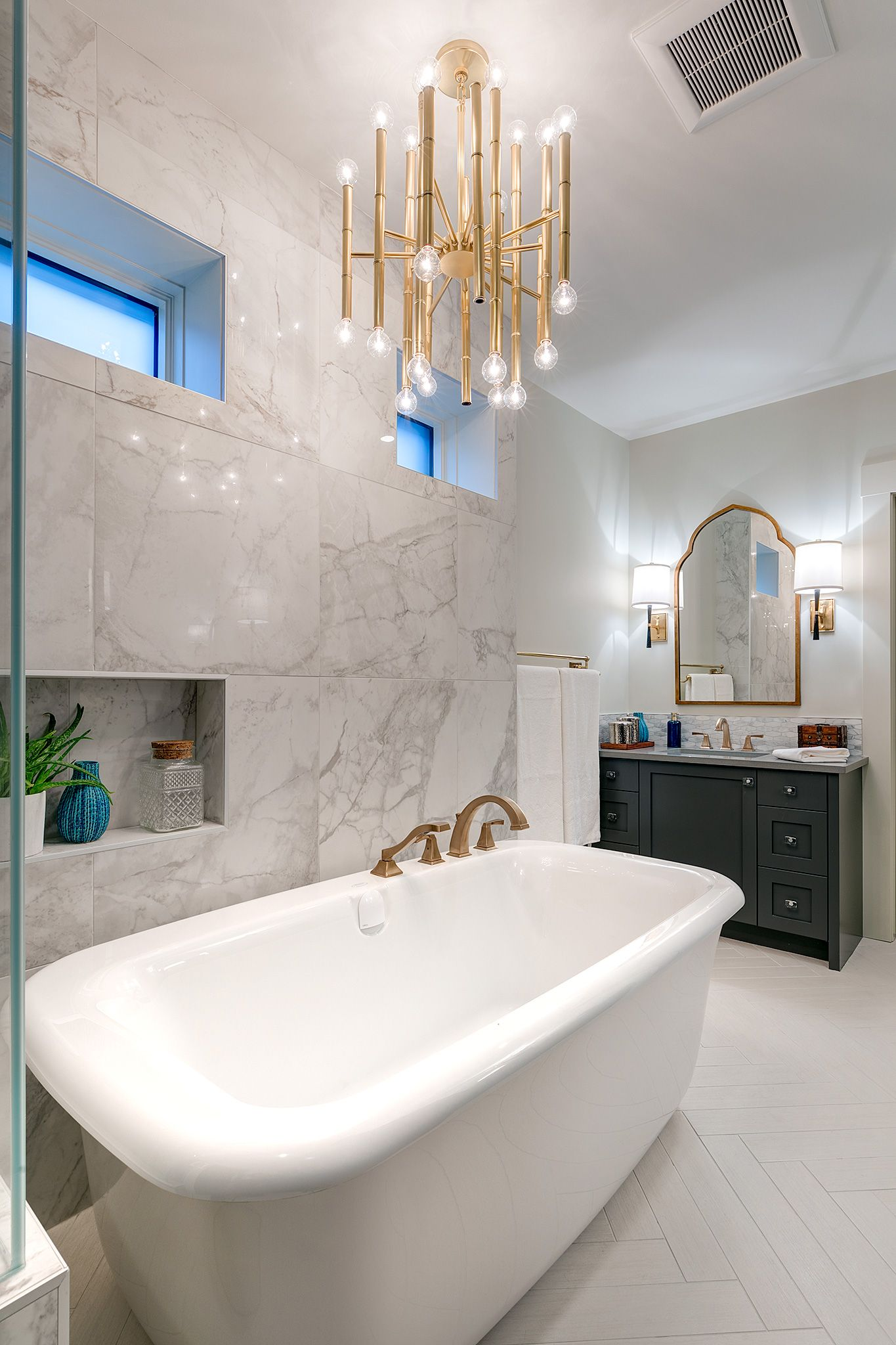 Ensuite Bathroom With Vintage Style Freestanding Bathtub And Brass Fixtures