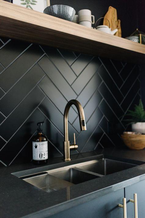 large black herringbone backsplash #kitchendesign #backsplashes #herringbone #woodfloortexture
