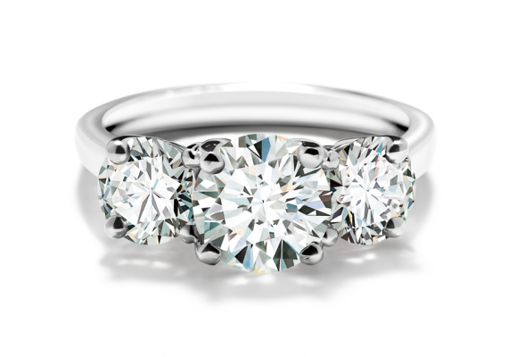 The diamond as the focal point never goes out of style as seen in this Forevermark Round 3 stone ring.