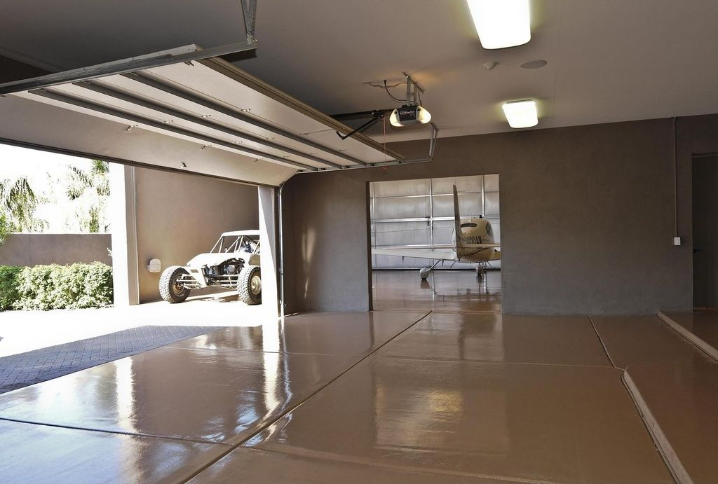 Contemporary Garage With High Ceiling Limestone Floors Flush