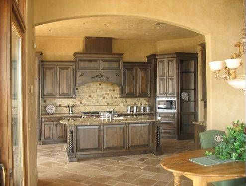 the natural and earthy feel of tuscan kitchen - like the