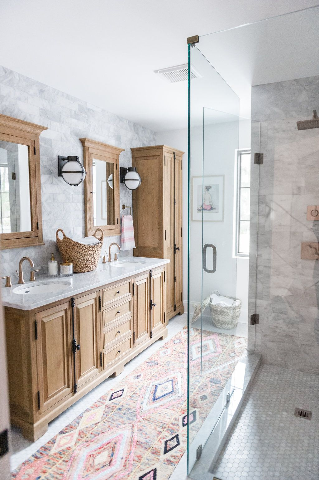 Beautiful wood cabinet bathroom with marble tiles and glass shower ...