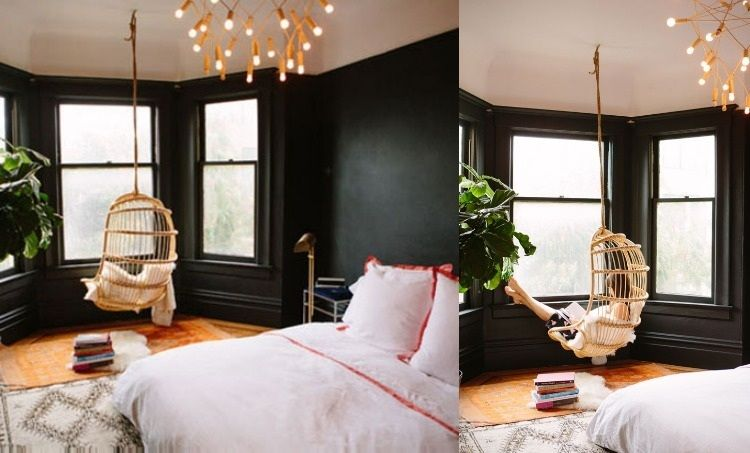 Schlafzimmer Rattan ~ Schlafzimmer mit wandfarbe schwarz und hängesesel vor den fenstern