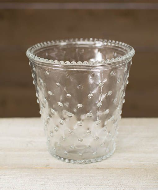 This clear glass holder is accented with a hobnail pattern and edge. Use it as a candle holder to illuminate your special event or as a holder for table numbers.