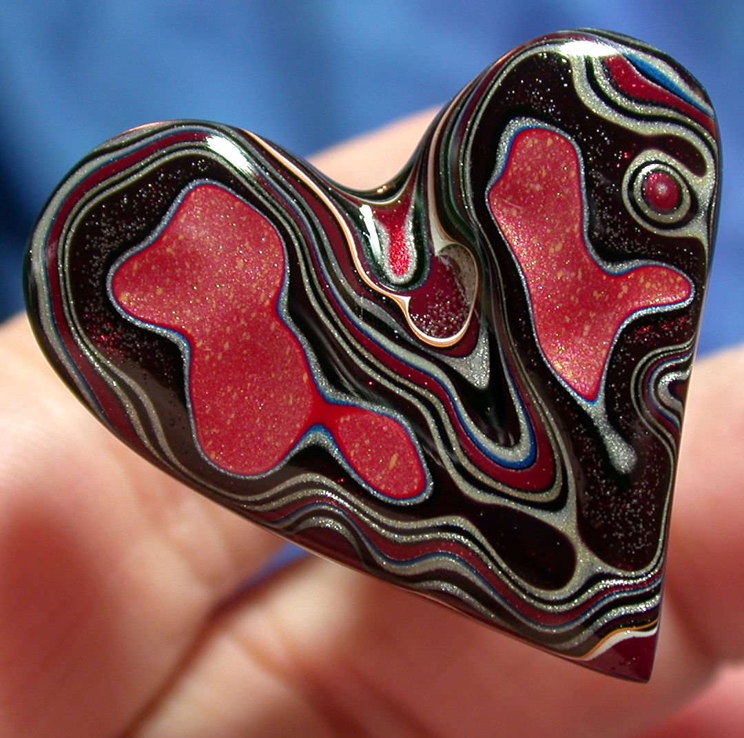 Fordite...not a real gem but made from old paint layers in the Ford Motor plant.