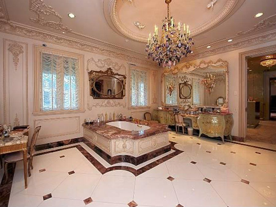 French decor, master bathroom has a tub, dressing areas, an antique ...