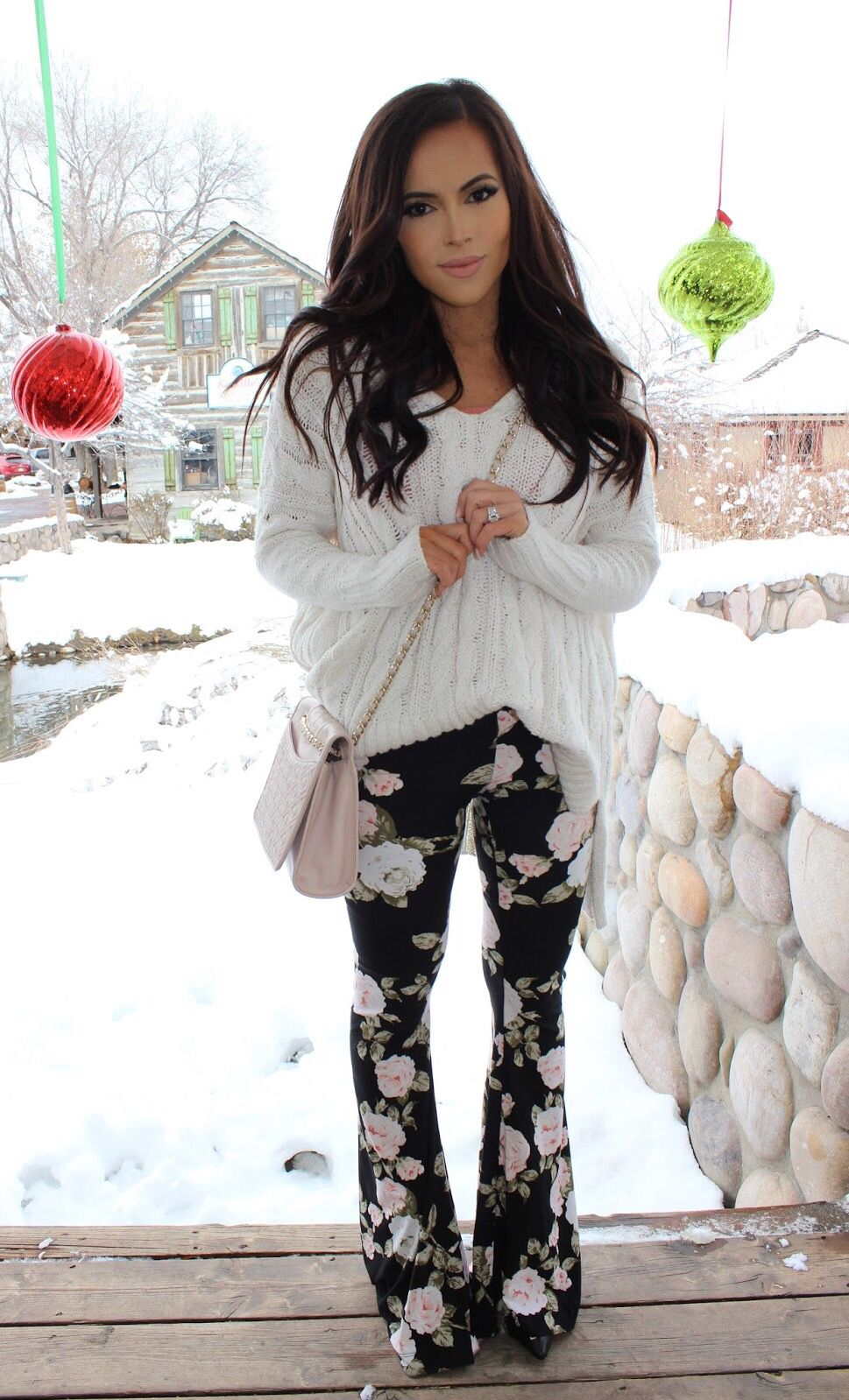 high waisted black floral flared pants with easy cable knit cream white sweater.