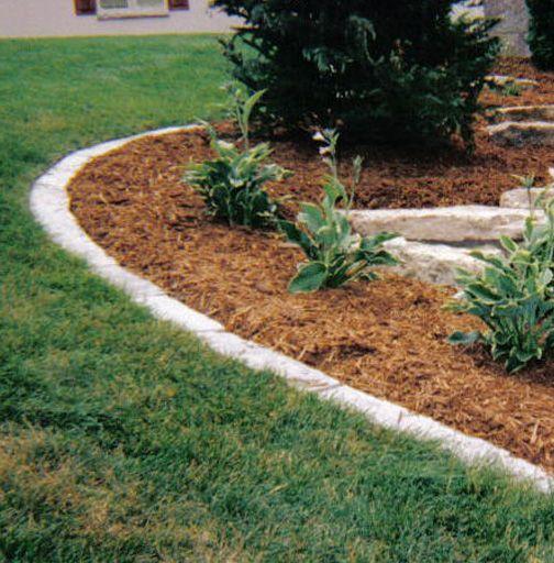 Simple landscape edging light natural stone edging for Simple garden edging ideas