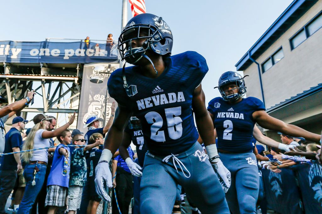 Defensive Back Daniel Brown Of The Nevada Wolf Pack Passes Fans On Nevada Wolf Pack Defensive Back Wolf Pack