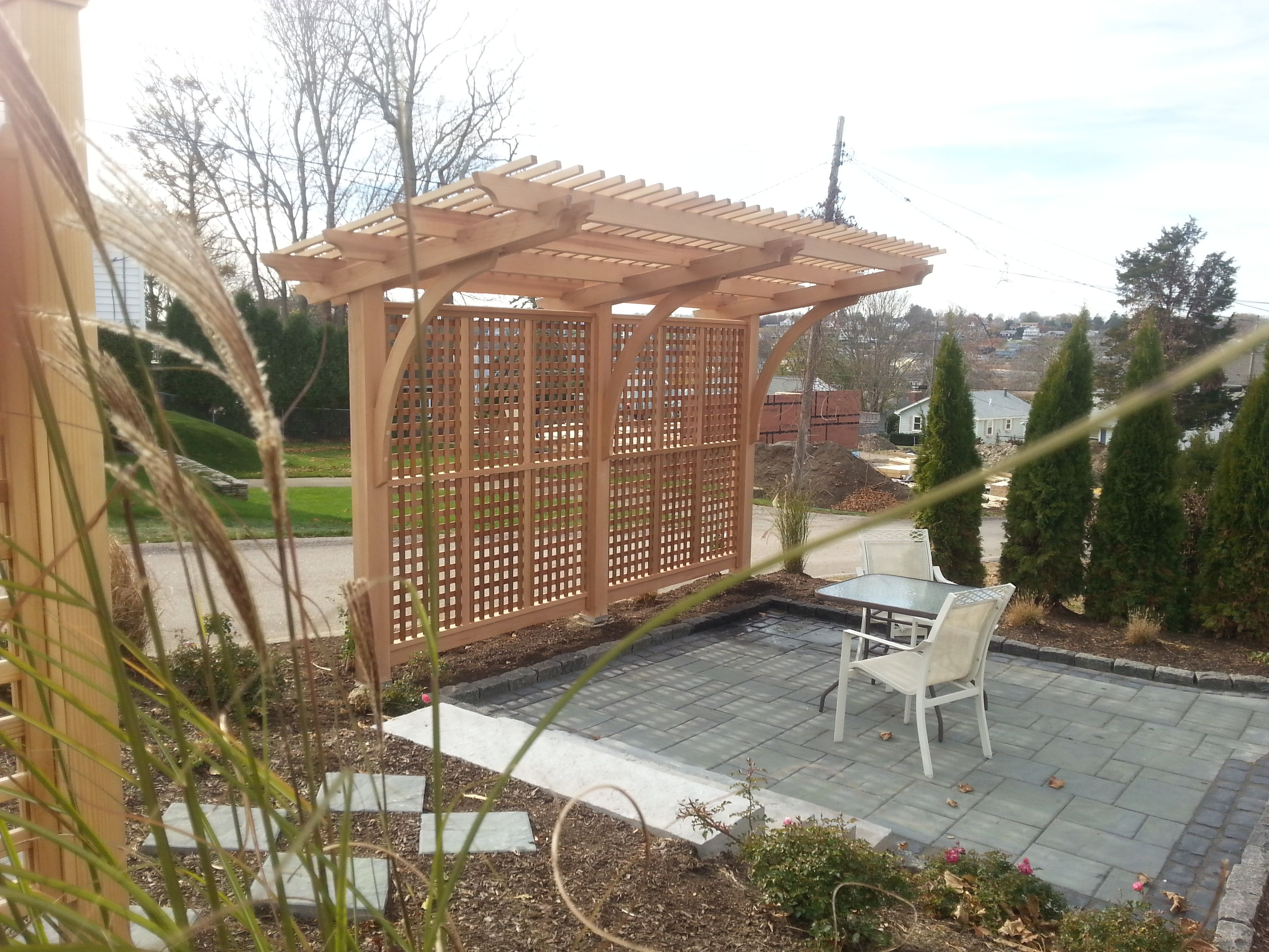 Custom trellis to match pergola landscapes by earth design - Cantilevered Pergola Cedar Structure With Mahogany Lattice Work