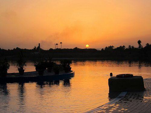 2013_03_31 - Sunset over the Infinity Pool and River Nile, Jolie Ville Hotel, Luxor, Egypt   We have the latest e-cigarette models and a great variety of e-liquid flavors. Visit us at www.e-cigarilicious.com