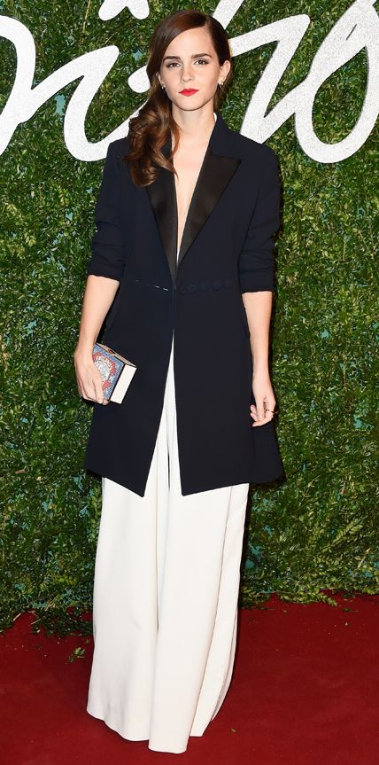 Emma Watson at the British Fashion Awards in a Misha Nonoo jumpsuit, Dior coat, Christian Louboutin shoes, and Anya Hindmarch clutch