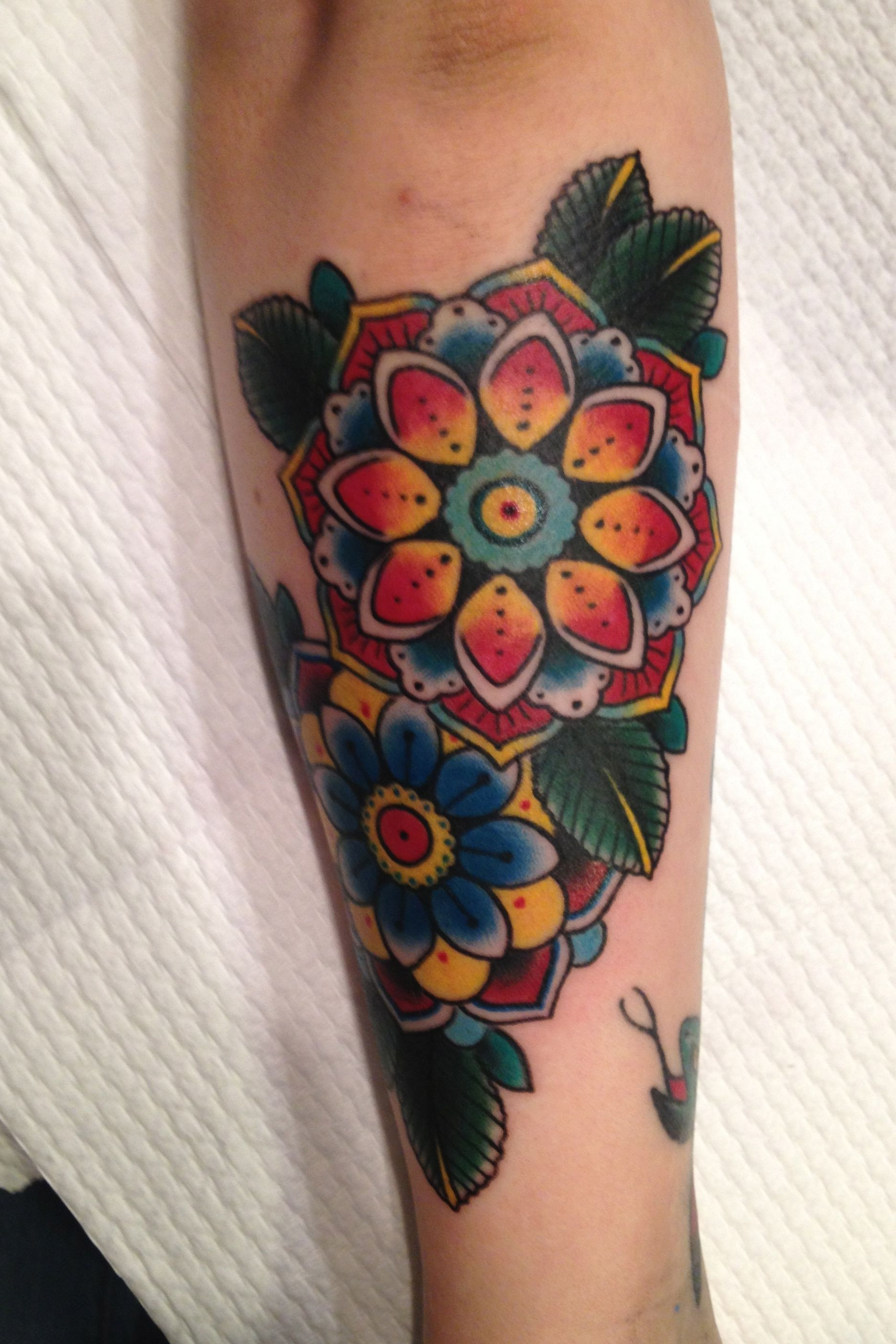 Traditional flower tattoo by Zoe Dennis Traditional