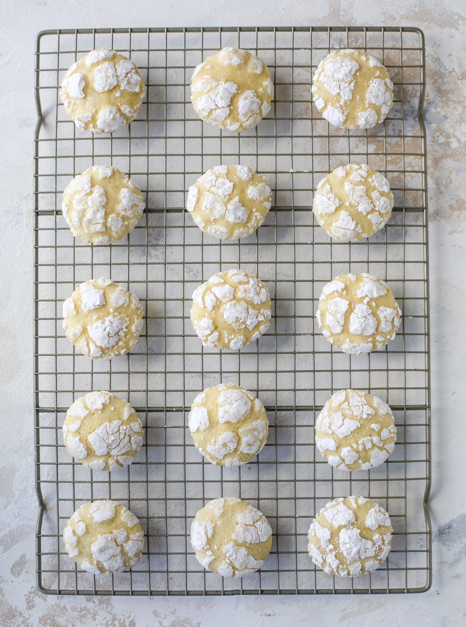 These lemon crinkle cookies are perfect if you love lemon desserts They take after chocolate crinkle cookies but are a delightful refreshing lemon flavor sprinkle with po...