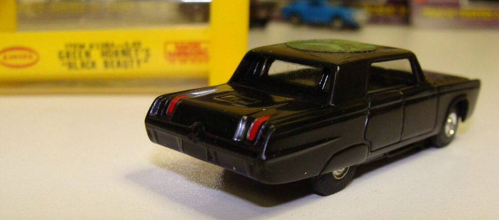 Vintage Aurora slot car of The Green Hornet's Black Beauty (ca. 1966) with original box in the background