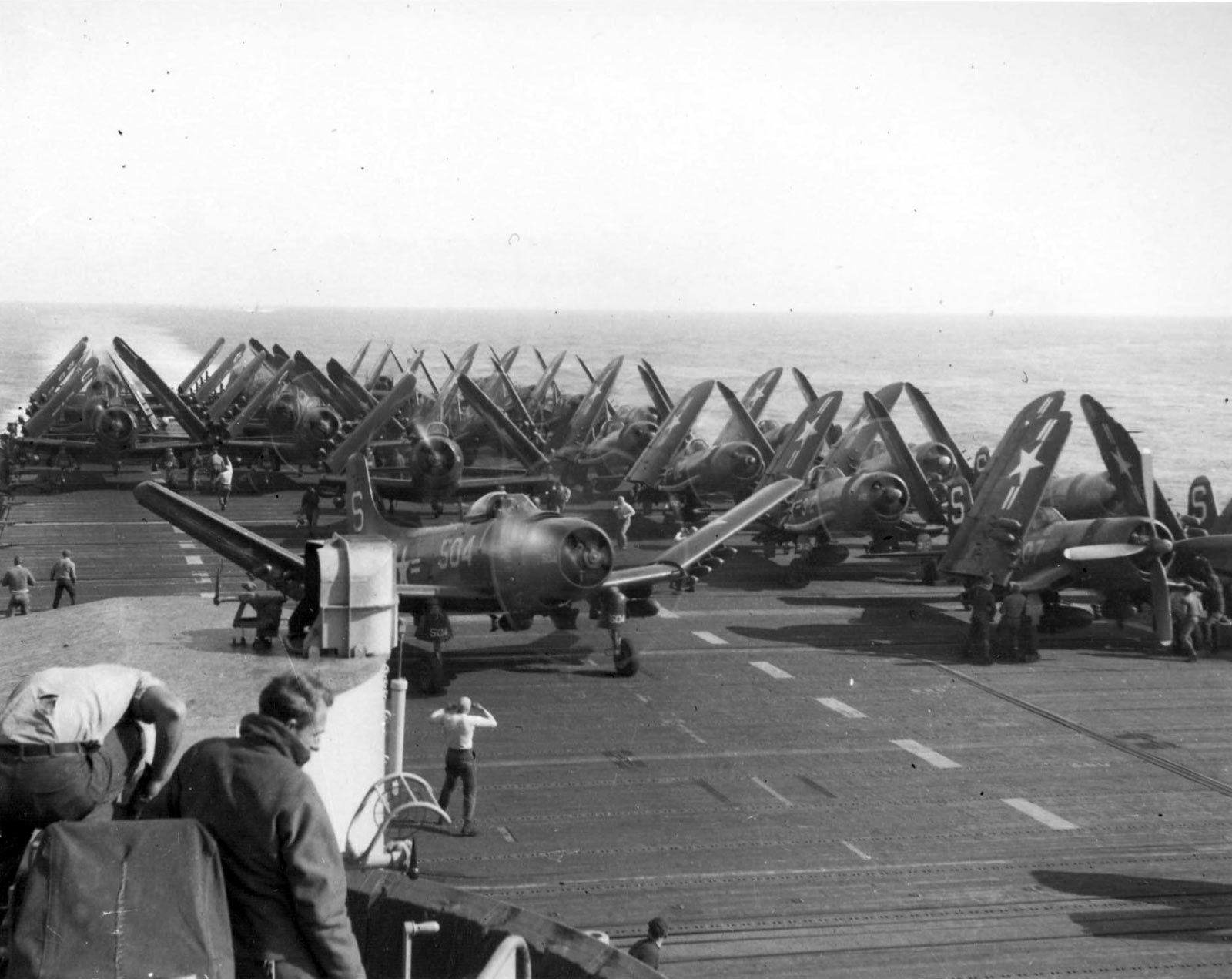 u s  navy aircraft on the flight deck of the uss valley forge  cv 45  preparing to launch for a