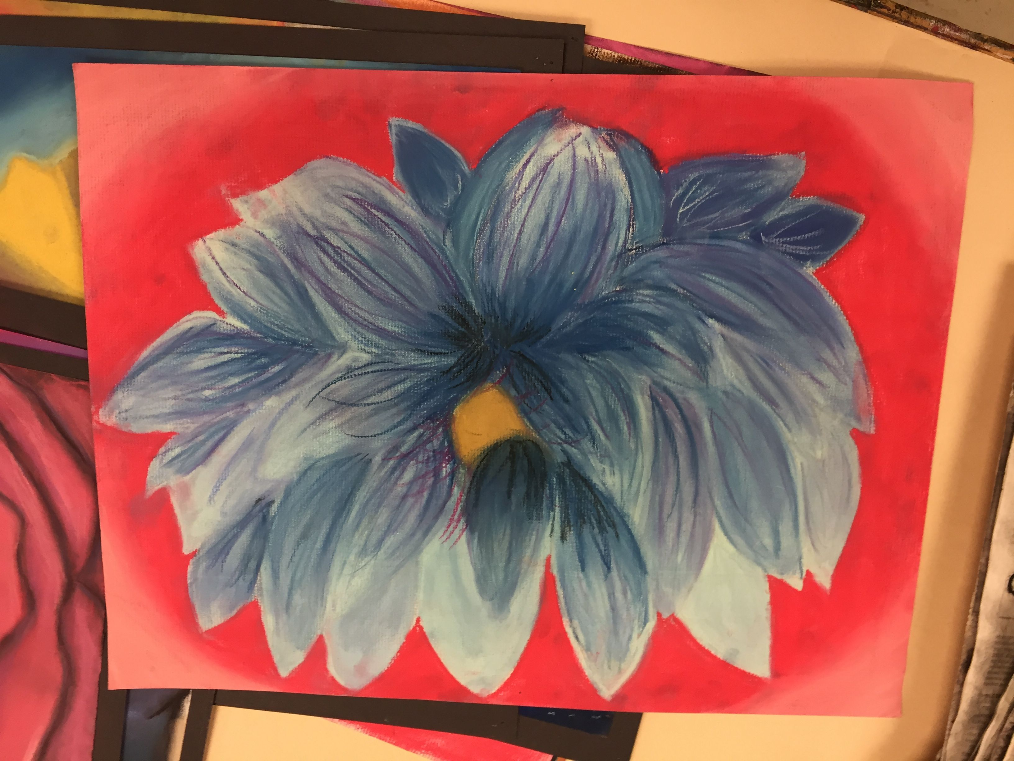 Medium: Pastel chalk This is a drawing of a lotus flower, colored with cool colors. I used the streak method for more value and detail.